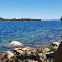 Lake Tahoe seen from rocky shore