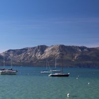 boats on lake tahoe with sierra range in background