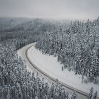 overhead view of mountain highway in winter