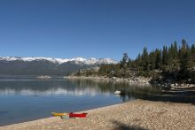 tahoe beach with mountains in background